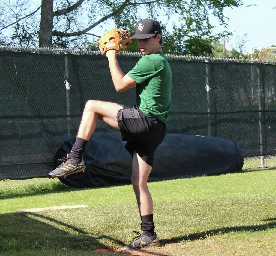 Kingwood Park pitcher Dylan Shoultz warming up in the bullpen at practice. Photo: Staff Photo/Marcus Gutierrez