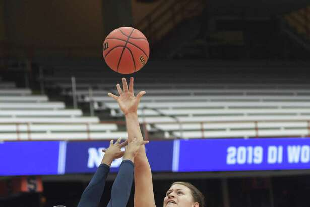 South Dakota State's Macy Miller attempts a basket against Quinnipiac's Aryn McClure during a first round of NCAA Tournament game in Syracuse, N.Y. Saturday.