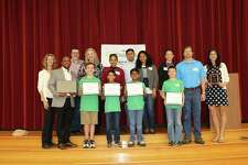 Thursday morning at Coulson Tough Elementary, a team of four sixth graders were honored with an award from Toshiba International and the National Science Teachers Association for being regional winners in the ExploraVision competition, one of the world's largest K-12 STEM competitions.
