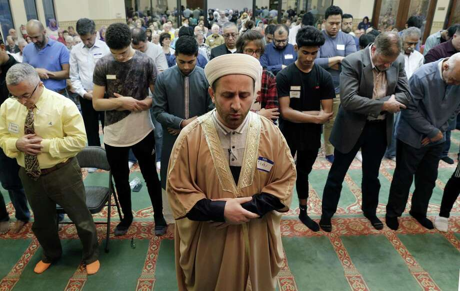 "Attendants line up inside the mosque as evening prayers start the program during the ""Standing As One Healing After New Zealand"" event, a prayer and remarks vigil with community and local faith leaders at The Woodlands Muslim Community at Masjid Al-Ansaar Mosque Friday, March, 22, 2019 in The Woodlands, TX. Photo: Michael Wyke, Houston Chronicle / Contributor / © 2019 Houston Chronicle"
