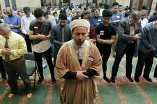 """Attendants line up inside the mosque as evening prayers start the program during the """"Standing As One Healing After New Zealand"""" event, a prayer and remarks vigil with community and local faith leaders at The Woodlands Muslim Community at Masjid Al-Ansaar Mosque Friday, March, 22, 2019 in The Woodlands, TX."""