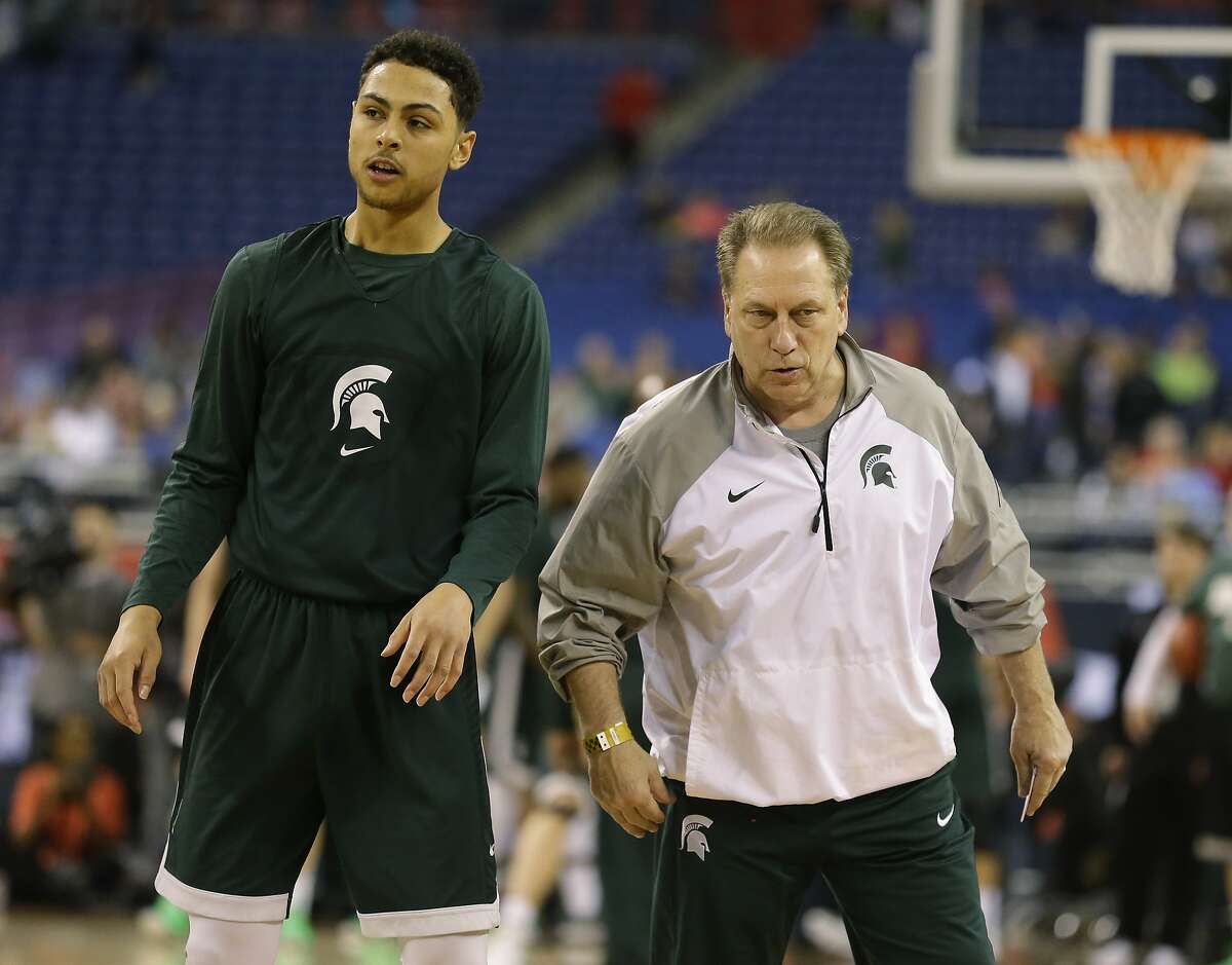 Michigan State head coach Tom Izzo talks to Bryn Forbes during a practice session for the NCAA Final Four tournament college basketball semifinal game Friday, April 3, 2015, in Indianapolis. Michigan State plays Duke on Saturday. (AP Photo/Michael Conroy)