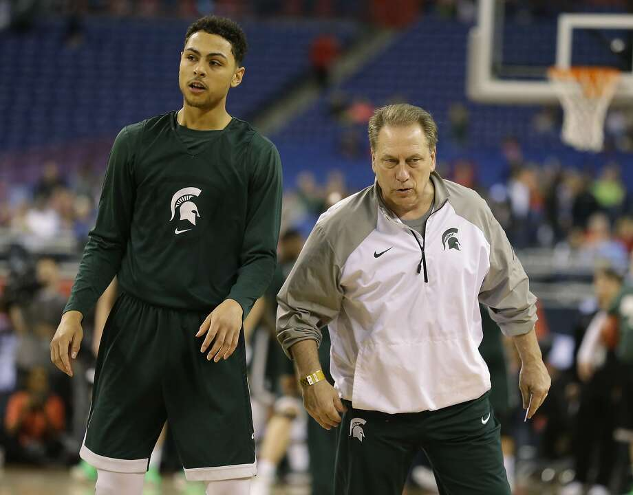 Michigan State head coach Tom Izzo talks to Bryn Forbes during a practice session for the NCAA Final Four tournament college basketball semifinal game Friday, April 3, 2015, in Indianapolis. Michigan State plays Duke on Saturday. (AP Photo/Michael Conroy) Photo: Michael Conroy, Associated Press