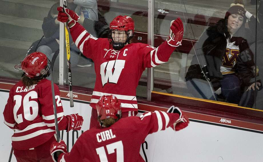 Wisconsin's Annie Pankowski celebrates with teammates after scoring an empty net goal in the third period against Minnesota during the WCHA Final Faceoff championship game on March 10, 2019 at Ridder Arena in Minneapolis. The teams will play for the NCAA championship Sunday. Photo: Carlos Gonzalez / TNS / Minneapolis Star Tribune