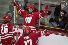 Wisconsin's Annie Pankowski celebrates with teammates after scoring an empty net goal in the third period against Minnesota during the WCHA Final Faceoff championship game on March 10, 2019 at Ridder Arena in Minneapolis. The teams will play for the NCAA championship Sunday.