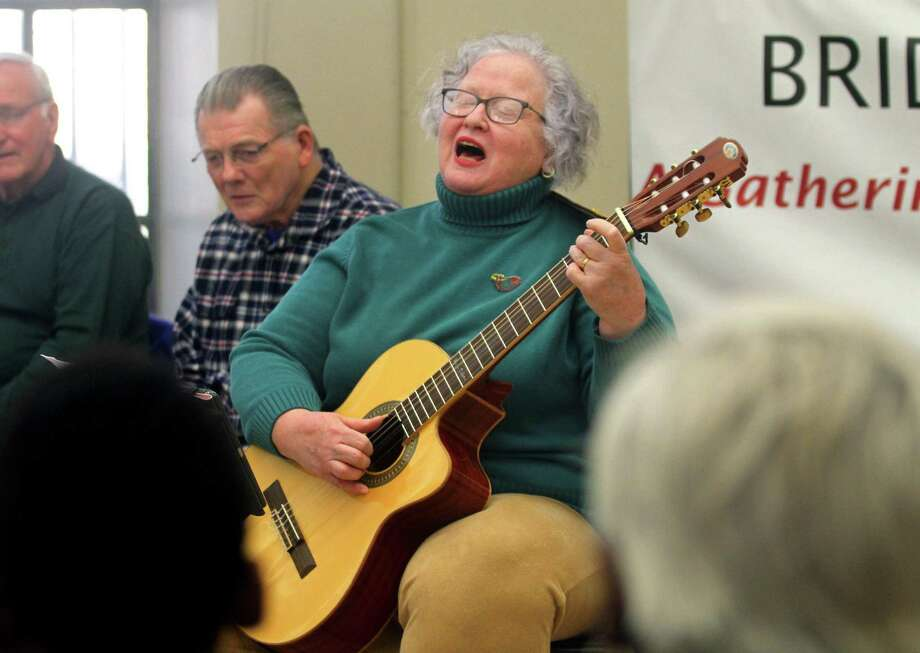 Mary Ellen Lyons performs during a concert by The Shamrogues at the Bridgeport Public Library in Bridgeport, Conn., on Saturday, Mar. 23, 2019. The band entertained the audience with traditional Irish songs, jigs and reels. They all played on traditional instruments like the fiddle, tin whistle and mandolin among others. The band, which is known as the largest Irish band in Connecticut, practices every Monday at 8 p.m. at the Gaelic-American Club in Fairfield. Photo: Christian Abraham / Hearst Connecticut Media / Connecticut Post