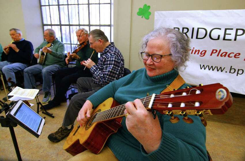 Mary Ellen Lyons performs during a concert by The Shamrogues at the Bridgeport Public Library in Bridgeport, Conn., on Saturday, Mar. 23, 2019. The band entertained the audience with traditional Irish songs, jigs and reels. They all played on traditional instruments like the fiddle, tin whistle and mandolin among others. The band, which is known as the largest Irish band in Connecticut, practices every Monday at 8 p.m. at the Gaelic-American Club in Fairfield.