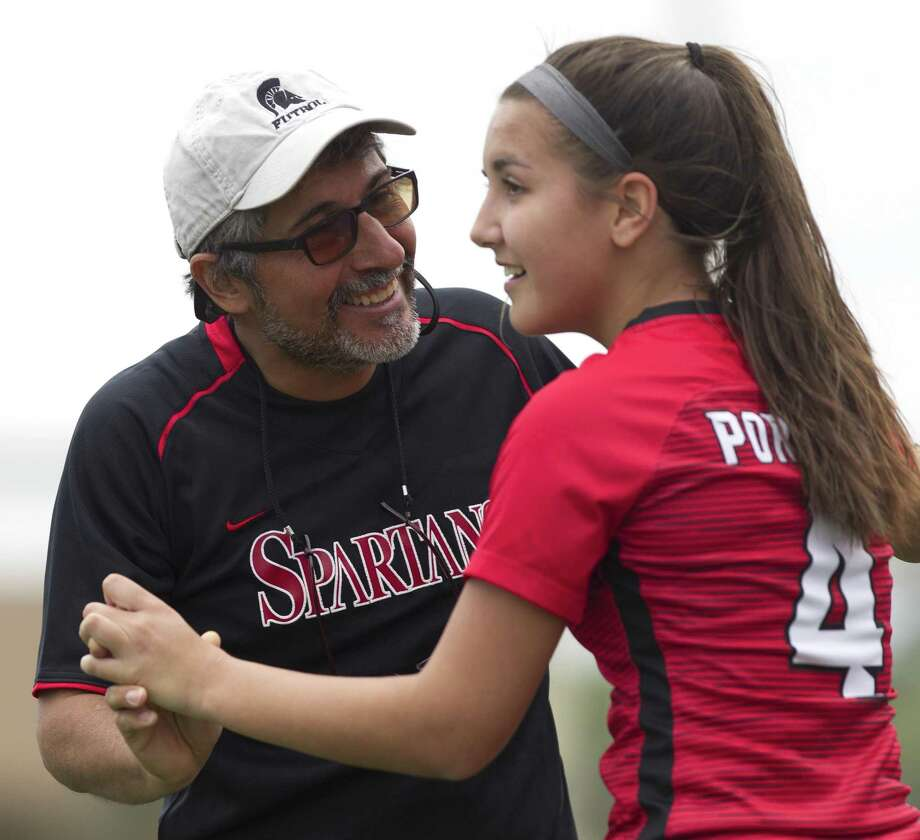 Porter head coach Luis Valle reacts with midfielder Felicity Fritsch (4) after her goal during the second period of a District 20-5A high school girls soccer match at Texan Drive Stadium, Saturday, March 23, 2019, in New Caney. Photo: Jason Fochtman, Houston Chronicle / Staff Photographer / © 2019 Houston Chronicle