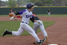 Willis designated hitter Daniel Shafer (19) makes it to first base during a District 20-5A baseball game Saturday, March 23, 2019 in Willis.