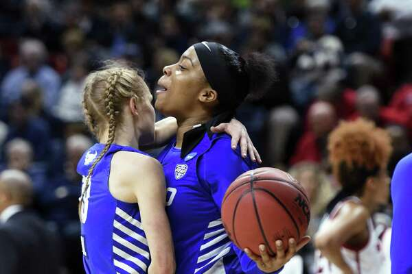 Buffalo's Cierra Dillard, right, chest-bumps Hanna Hall at the buzzer of the team's win over Rutgers during a first-round NCAA tournament game on Friday.