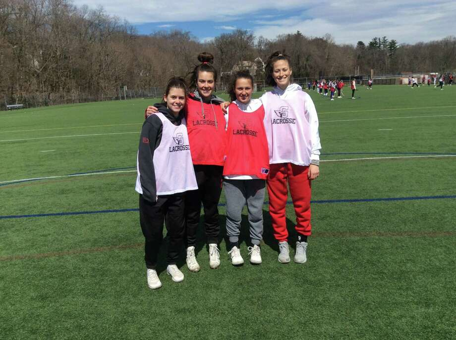 From left, Sloane Loveless, Olivia Hoekman, Paige Finneran and Grace Fahey are senior captains of the Greenwich High School girls lacrosse team. Photo: David Fierro / Hearst Connecticut Media