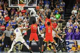 Maryland forward Jalen Smith (25) just misses blocking the game winning lay-up by LSU guard Tremont Waters (3) during second-round action of the NCAA Tournament.