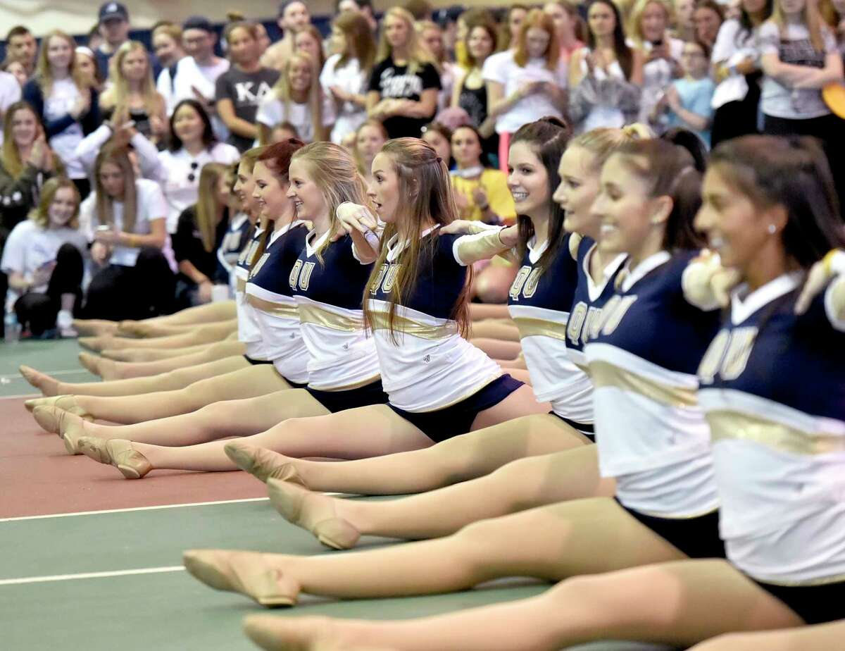 Hamden, Connecticut - Saturday, March 23, 2019: Quinnipiac University cheerleaders perform as QU students dance for 10-hours Saturday in the school's Athletic Center in Hamden during QTHON, who are attempting to raise $323,000 for the Connecticut Children's Medical Center, a comprehensive pediatric hospital in Hartford.