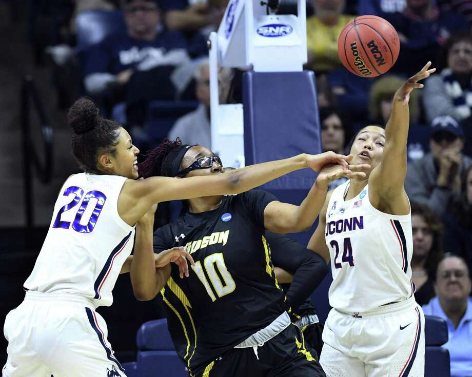 UConn's Olivia Nelson-Ododa (20) and Napheesa Collier defend against Towson's Janeen Camp during a NCAA tournament first-round game Friday in Storrs. Photo: Stephen Dunn / Associated Press / Copyright 2019 The Associated Press. All rights reserved