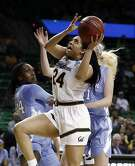 California guard Recee' Caldwell (24) gets past North Carolina center Naomi Van Nes, left, and Taylor Koenen, rear, for a shot in the first half of a first round women's college basketball game in the NCAA Tournament in Waco, Texas, Saturday March 23, 2019.(AP Photo/Tony Gutierrez)