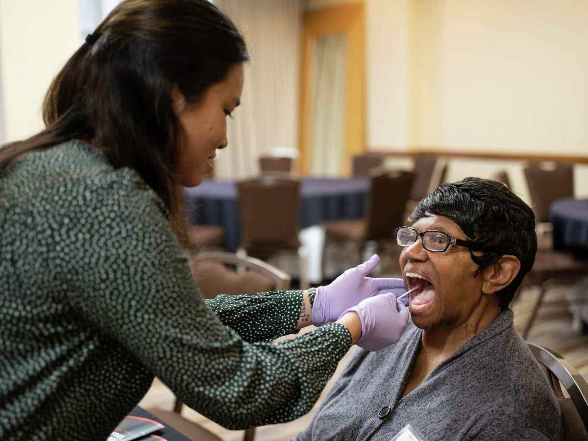 Mercer Mae Butler, relative of CPL Clifton F. Pines who served in the Army in Korea, has her mouth swabbed for DNA by Lalana Taylor, a DNA analyst, during an event hosted by the United States' Defense POW/MIA Accounting Agency where military families were given information about their missing military relatives in San Antonio on Saturday, March 23, 2019. Butler's DNA swab will be taken back to Dover Air Force Base for further testing to find out more information about her lost loved one.