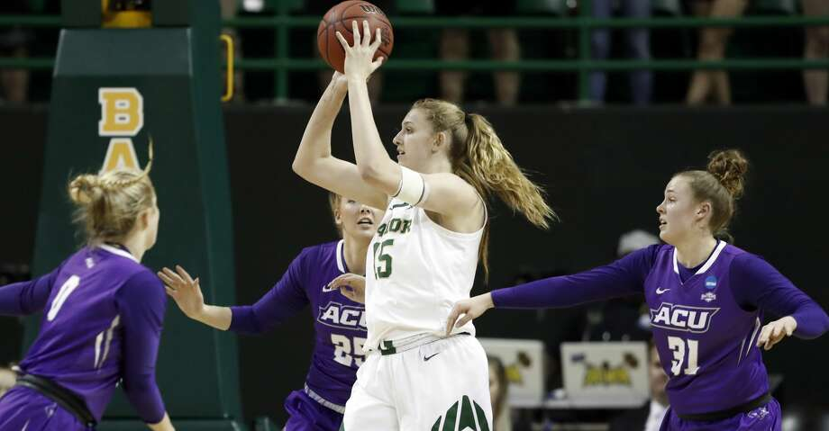 Baylor forward Lauren Cox (15) looks to make a pass as Abilene Christian 's Kamryn Mraz (0), Lexi Kirgan (25) and Madi Miller (31) defend in the first half of a first-round game in the NCAA women's college basketball tournament in Waco, Texas, Saturday March 23, 2019.(AP Photo/Tony Gutierrez) Photo: Tony Gutierrez/Associated Press