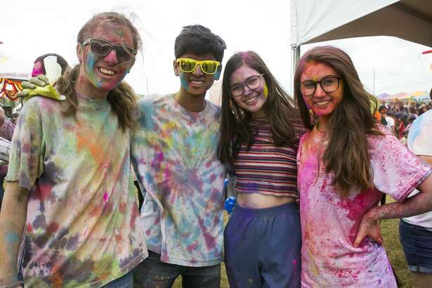 Attendees show their colorful smiles during Houston Holi's Indian Festival of Colors in Spring on Saturday, Mar. 23, 2019, at The Crown Festival Park in Sugar Land.