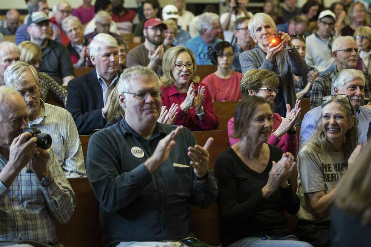 Constituents of the 7th Congressional District applaud as Rep. Lizzie Fletcher, D-Texas, arrives to her first town hall meeting at Frostwood Elementary School on Saturday, March 23, 2019, in Houston.