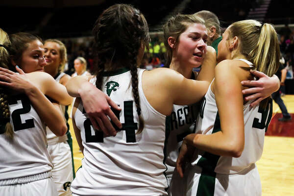 Freeland's Alyssa Argyle hugs teammates after the Falcons' 58-77 state finals loss to Detroit Edison on Saturday, March 23, 2019 at the Van Noord Arena in Grand Rapids. (Katy Kildee/kkildee@mdn.net)