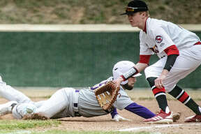 Civic Memorial's Gavin Lyday (15) dives back into first base just under the tag of Alton High first baseman Riley Phillips (11) Saturday during the Redbirds' see-saw 11-10 eight-inning victory over the Eagles at AHS. Michael Reeder led Alton batters with three hits with two RBIs. Four other Redbirds had a pair of hits.