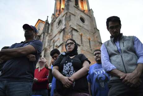 People of many faiths gather and pray in Main Plaza on Saturday for the victims of the mosque attacks in New Zealand a week ago.