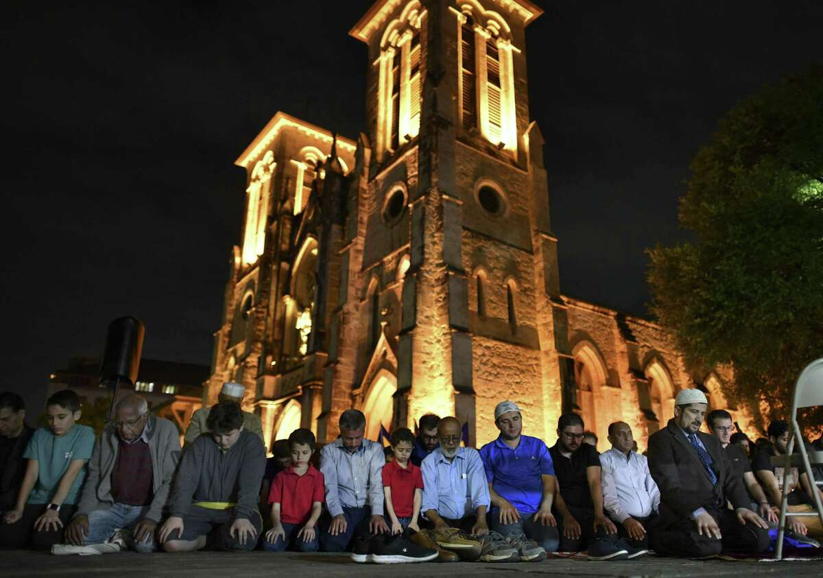 Muslims pray in Main Plaza during a vigil by people of many faiths on Saturday, March 23, 2019. The gathering was to remember the victims of the mosque attacks in New Zealand a week ago. The event was put on by the Muslim Children Education and Civic Center & Turkish Raindrop House.