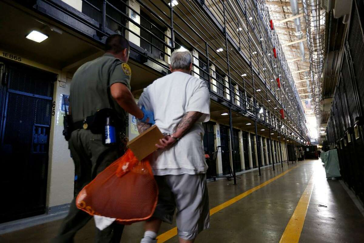 A Death Row inmate is escorted back to his cell after spending time in the yard at San Quentin State Prison.