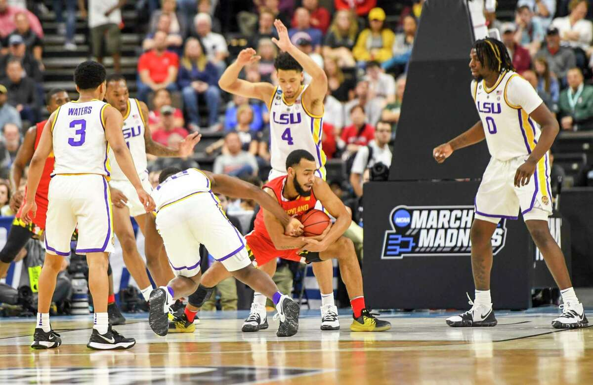 Maryland guard Eric Ayala (5) is surrounded by five LSU defenders during second round action of the NCAA Tournament on March 23 in Jacksonville, Florida.