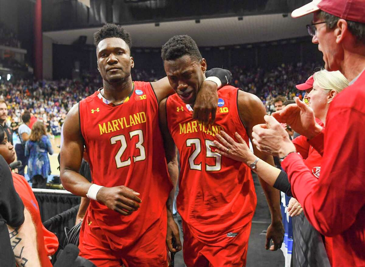 Bruno Fernando, left, comforts teammate Jalen Smith after LSU beat Maryland, 69-67, to oust the Terrapins from the NCAA Tournament on Saturday.