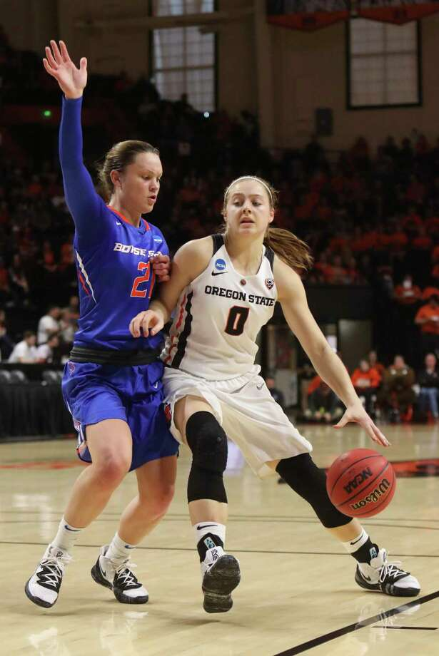 Oregon State's Mikayla Pivec (0) tries to work around Boise State's Riley Lupfer (21) during the first half of a first-round game of the NCAA women's college basketball tournament in Corvallis, Ore., Saturday, March 23, 2019. (AP Photo/Amanda Loman) Photo: Amanda Loman / Copyright 2019 Associated Press. All Rights Reserved.