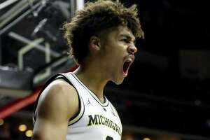 DES MOINES, IOWA - MARCH 23: Jordan Poole #2 of the Michigan Wolverines celebrates a basket against the Florida Gators during the second half in the second round game of the 2019 NCAA Men's Basketball Tournament at Wells Fargo Arena on March 23, 2019 in Des Moines, Iowa. (Photo by Jamie Squire/Getty Images)