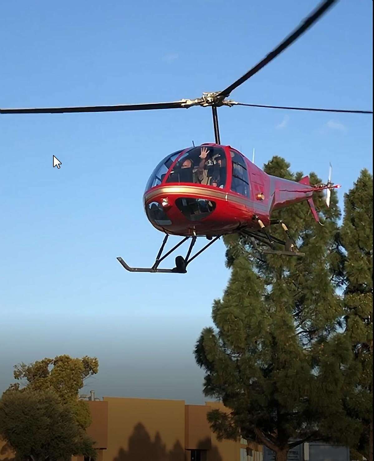 This private helicopter made an emergency landing in a Kmart parking lot in Redwood City because of a minor mechanical problem, police said. Saturday March 23, 2019.