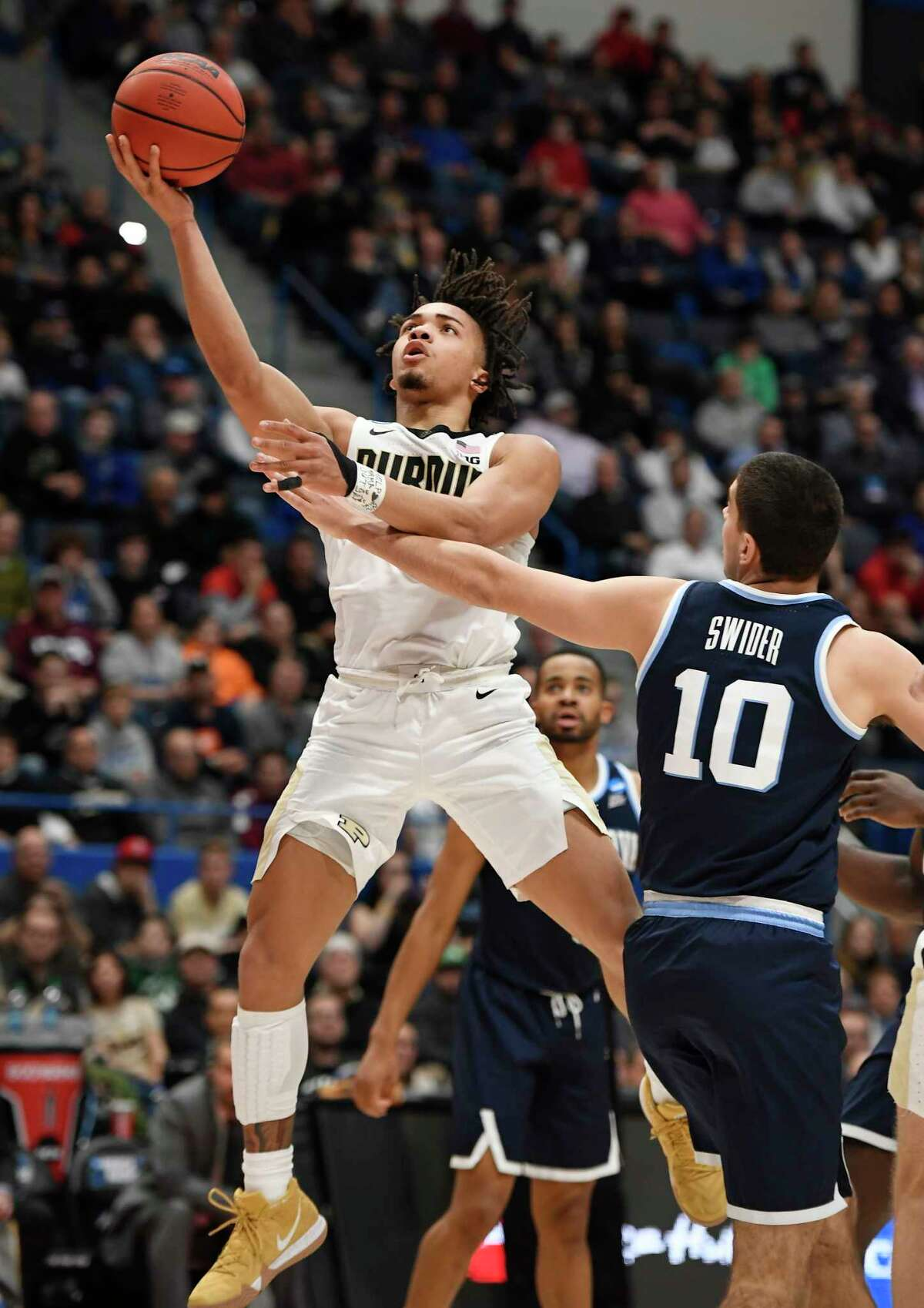 Purdue's Carsen Edwards (3) is fouled by Villanova's Cole Swider (10) during the second half of a second round men's college basketball game in the NCAA tournament, Saturday, March 23, 2019, in Hartford, Conn. (AP Photo/Jessica Hill)