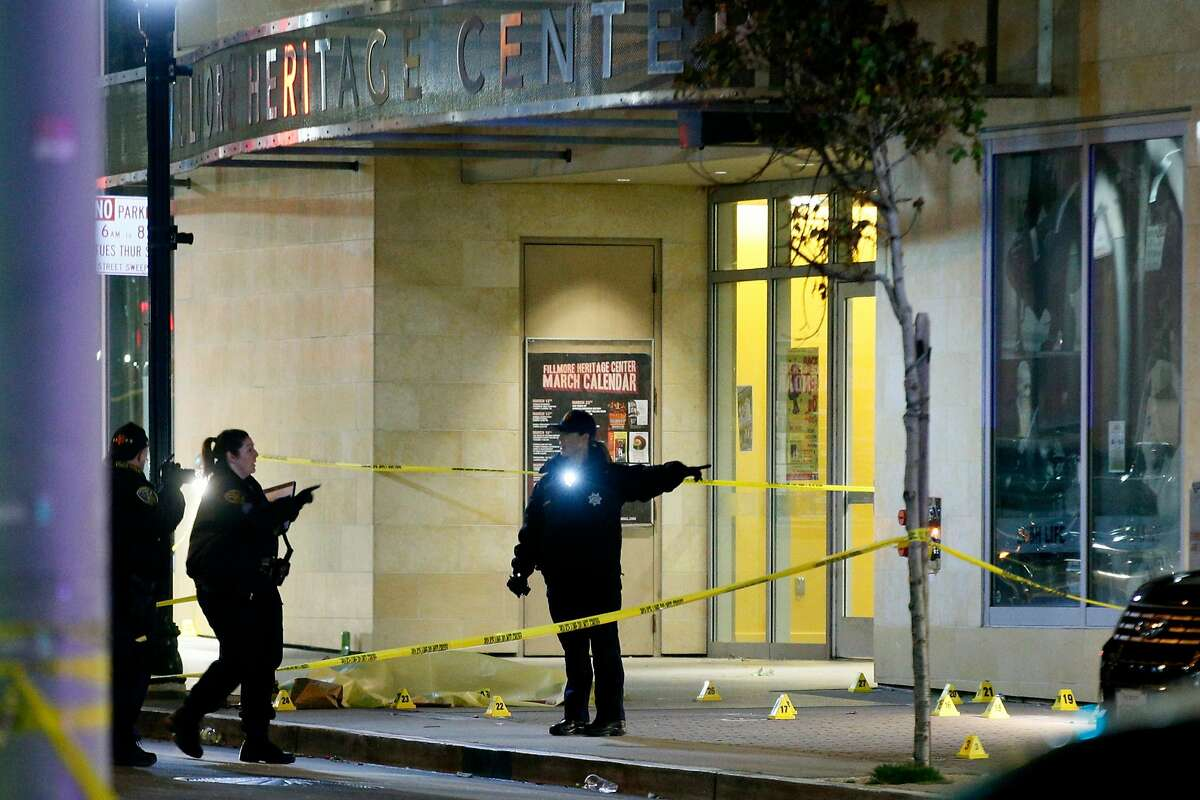 A body bag at the scene of a shooting outside the Fillmore Heritage Center on Saturday, March 23, 2019, in San Francisco, Calif. Police said one is dead and several injured after a shooting.