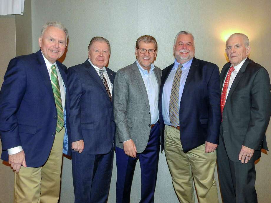 UConn Women's Basketball Coach Geno Auriemma spoke at a Middlesex County Chamber of Commerce Member Breakfast March 18. From left are Corporate Underwriting Manager at MiddleOak, William Haggerty; Chamber Chairman Jay Polke, Auriemma, Vice Chairman Don DeVivo and Chamber President Larry McHugh. Photo: De Kine Photo LLC