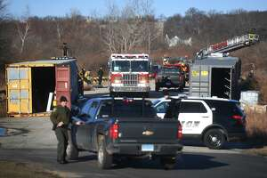 Milford firefighters and police are on scene for a storage container fire at Silver Sands State Park in Milford, Conn. on Sunday, March 24, 2019. The containers hold supplies for the ongoing construction project at the park. Newly constructed concessions, bathrooms, and park offices were totally destroyed in a fire last Tuesday.