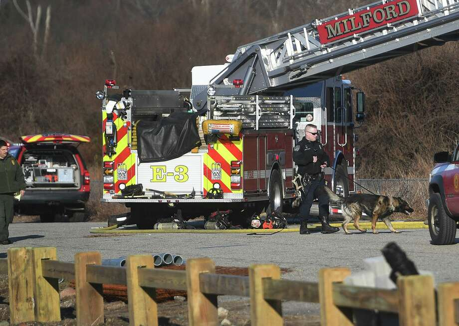 Milford police investigate the scene of a storage container fire at Silver Sands State Park in Milford, Conn. on Sunday, March 24, 2019. The containers hold supplies for the ongoing construction project at the park. Newly constructed concessions, bathrooms, and park offices were totally destroyed in a fire last Tuesday. Photo: Brian A. Pounds / Hearst Connecticut Media / Connecticut Post