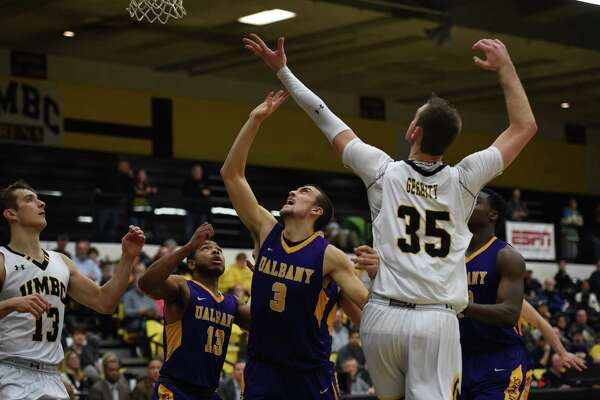 Joe Cremo (3) and David Nichols (13) of UAlbany wait to a rebound to come down against UMBC on Monday, Jan. 16, 2017. (Brian Gonzalez / Special to the Times Union)