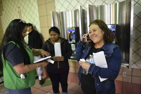 Honduran Francisca Martinez makes contact with family in the U.S. who agreed to pay for a ticket for her at the Laredo bus station this month. She must go before a judge who will decide on her asylum claim.
