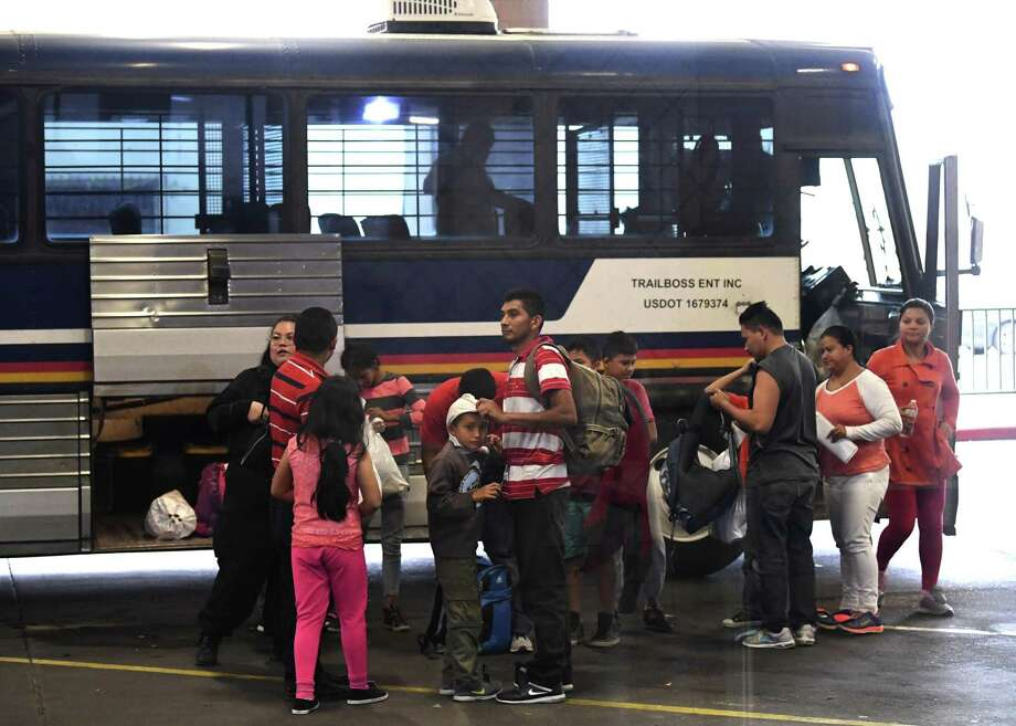 Central American migrants that were released after being taken into custody and processed are dropped off at the Laredo bus station on Friday, March 15, 2019, where they will board buses to their destinations. They will go before immigration judges who will decide on their asylum claims. Photo: Billy Calzada, Staff / Staff Photographer / San Antonio Express-News