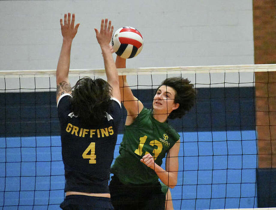 Metro-East Lutheran's Calvin Cunningham slams down a kill during the second game against Metro-East Lutheran on Saturday in Belleville. Photo: Matt Kamp/The Intelligencer