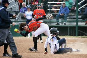 Edwardsville shortstop Maria Smith shows the umpire the ball after tagging out a would-be base stealer in Saturday's game against Mater Dei.