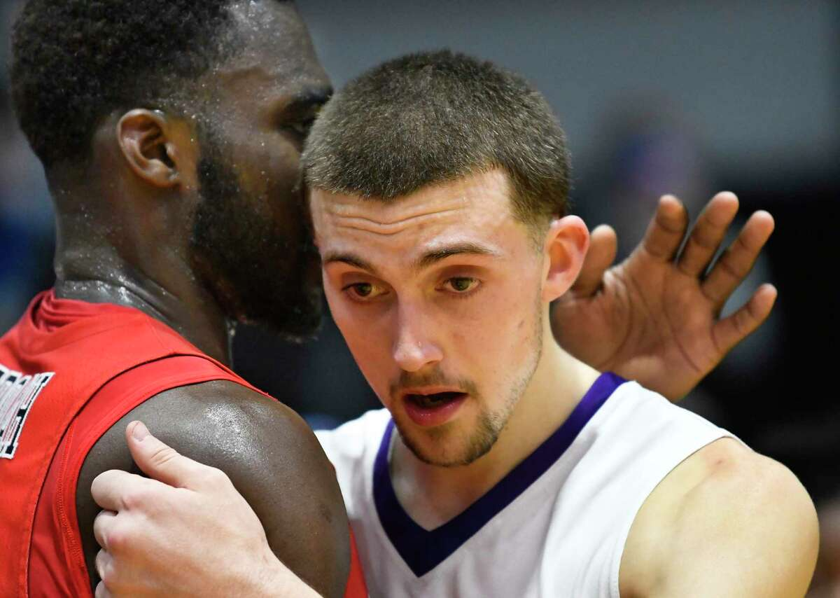 UAlbany guard Joe Cremo (24) reacts to a 69-60 loss to the Stony Brook Seawolves during the first half of an NCAA college basketball quarterfinal game in the America East Conference tournament, Saturday, March 3, 2018, in Albany, N.Y. (Hans Pennink / Special to the Times Union)