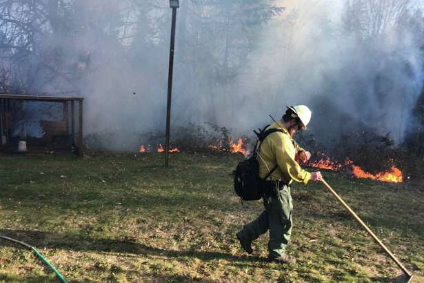 A firefighter at work during late winter/early spring wildfires.