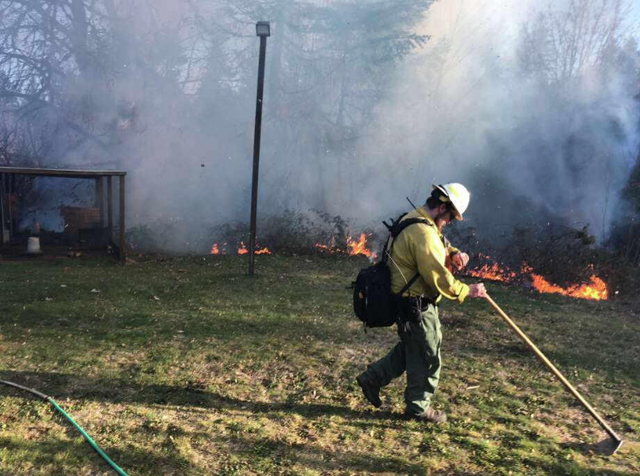 A firefighter at work during late winter/early spring wildfires. Photo: Washington State DNR