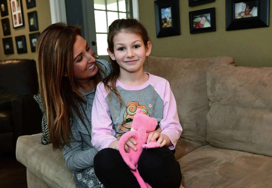 Erica DePalma, board member of the AG Bell Association for the Deaf and Hard of Hearing, with her hearing impaired daughter, Jameson DePalma, 7, at their home in Norwalk. DePalma is organizing an event for parents of children with hearing loss and their friends and families on April 17. The event, also open to professionals who treat children with hearing impairments, provides a networking opportunity for parents looking to share tips and find resources — and offers children living with disabilities the opportunity to forge friendships with each other. Childhood hearing loss is rare and some parents said they struggle to connect with families similar to theirs living in Fairfield County. Photo: Erik Trautmann / Hearst Connecticut Media / Norwalk Hour