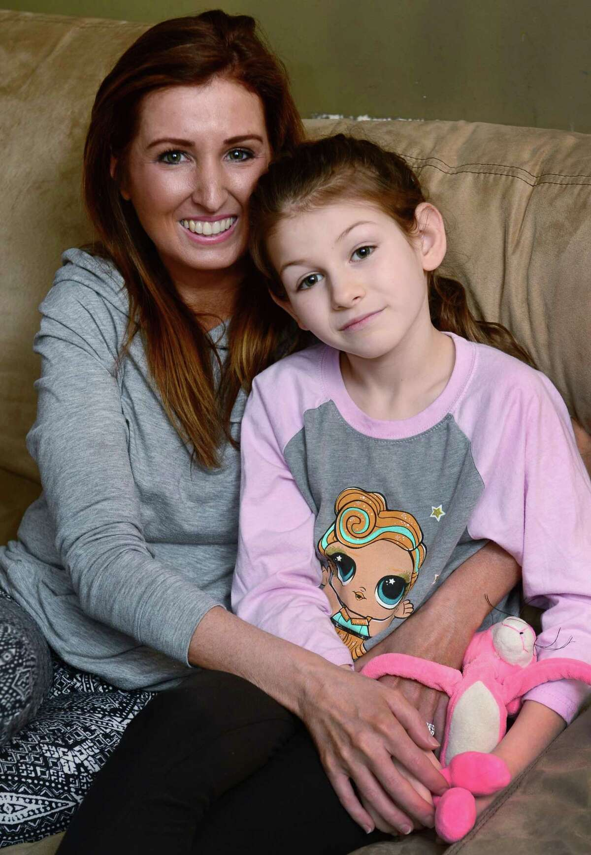 Erica DePalma, board member of the AG Bell Association for the Deaf and Hard of Hearing, with her hearing impaired daughter, Jameson DePalma, 7, at their home in Norwalk, Conn. DePalma is organizing an event for parents of children with hearing loss and their friends and families April 17, 2019. The event, also open to professionals who treat children with hearing impairments, provides a networking opportunity for parents looking to share tips and find resources -- and offers children living with disabilities the opportunity to forge friendships with each other. Childhood hearing loss is rare and some parents said they struggle to connect with families similar to theirs living in Fairfield County.