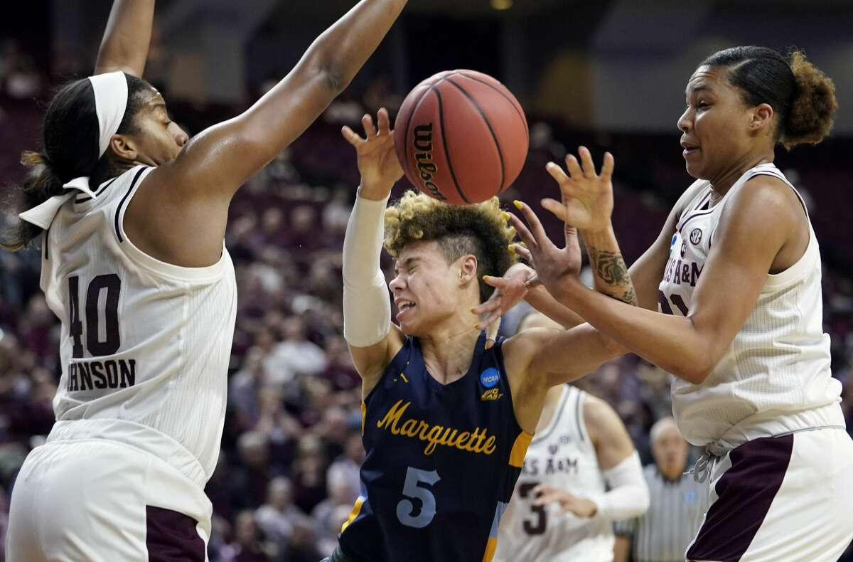 Marquette's Natisha Hiedeman (5) loses the ball out of bounds as Texas A&M's Ciera Johnson (40) and N'dea Jones, right, defend during the first half of a second round women's college basketball game in the NCAA Tournament Sunday, March 24, 2019, in College Station, Texas. (AP Photo/David J. Phillip)