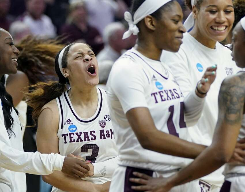 Texas A&M's Chennedy Carter (3) celebrates with teammates after a second round women's college basketball game against Marquette in the NCAA Tournament Sunday, March 24, 2019, in College Station, Texas. Texas A&M won 78-76. (AP Photo/David J. Phillip)